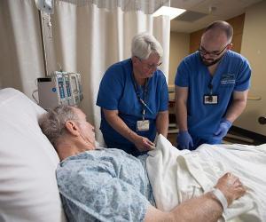 Nurses attending to patient